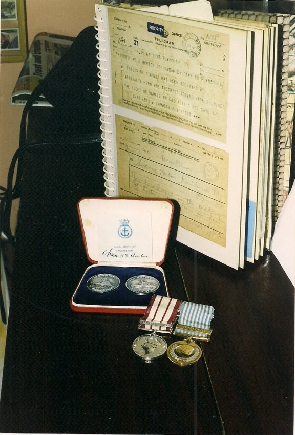 Sydney's medals,with the famous telegram, and the return home.