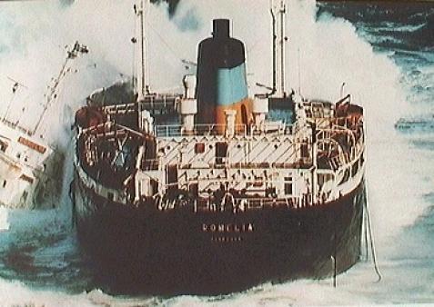 The Romelia aground with the tug alongside.