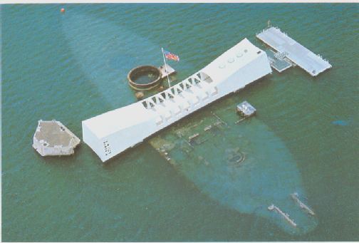 The Arizona memorial rests over the hull of the sunken battleship.