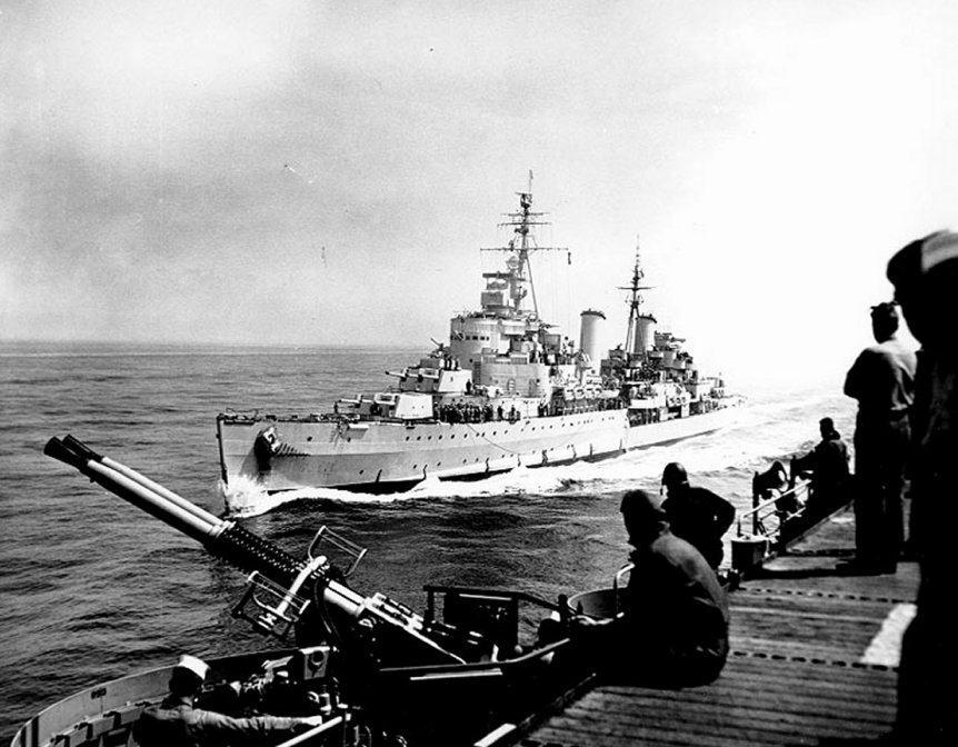 Belfast comes alongside USS. Bataan off Korea, May 1952