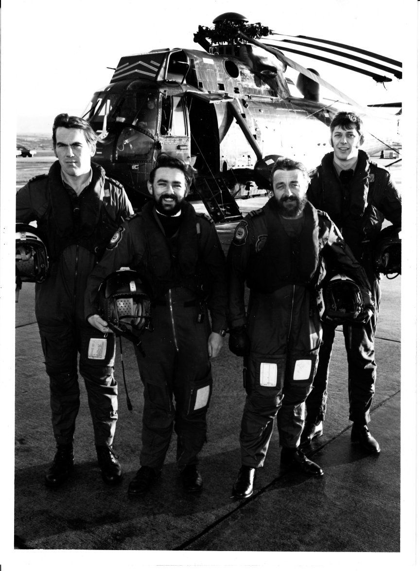 Lt Tony Hogg First Pilot, Lt Larry Jeram- Croft Second pilot, Lt Cdr Mike Norman Observer and a/c Captain, and Leading Aircrewman Jan Folland, Winch Operator. Leading Medical Attendant Brian Steele is not present. He was a volunteer from the sick bay at RNAS Culdrose.
