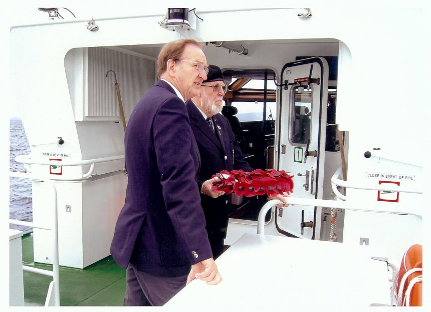 Brian with David Huges, Chairman of R.N.A. Orkney, laying a wreath on the Royal Oak.