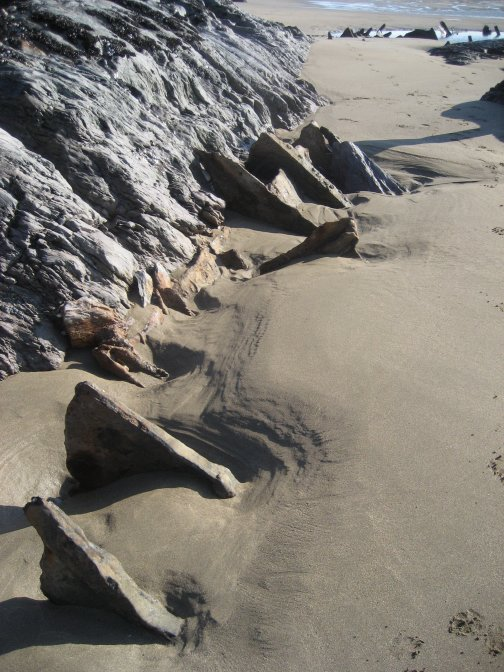 There is still quite a bit of wreckage buried deep in the sand.
