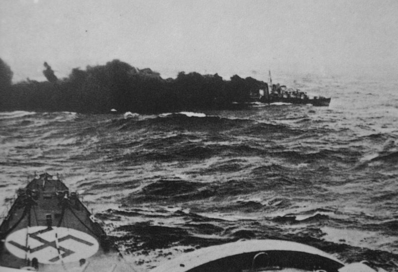 The Gloworm being sunk by the Admiral Hipper, who's bows are in the foreground.