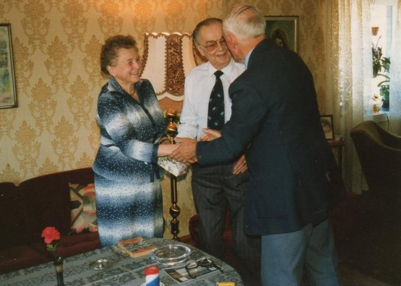 Mr. And Mrs. Haugland with Cyril Cope handing them a present from the family. Photo Ron.Cope.
