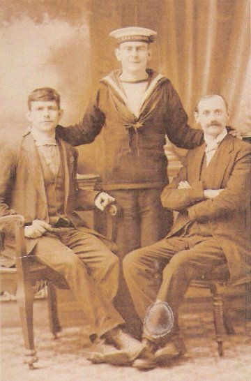 Stoker Peek is seen here with members of his family and wearing an 'H.M.S.Vengeance'cap tally.