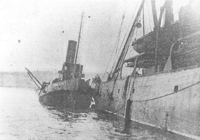 The Emilia with the tug Restorer.