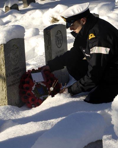 Alex at the grave of Captain Bernard Warburton-Lee. Photo Royal Navy.
