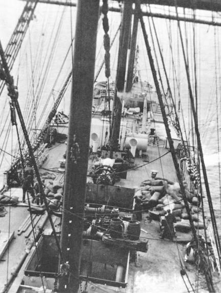 The rotting grain being removed from the wreck.