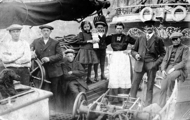 Photo of the crew. Chris verstappen's grandfather is on the right of the photo, and the dog is on the left. Both were saved.