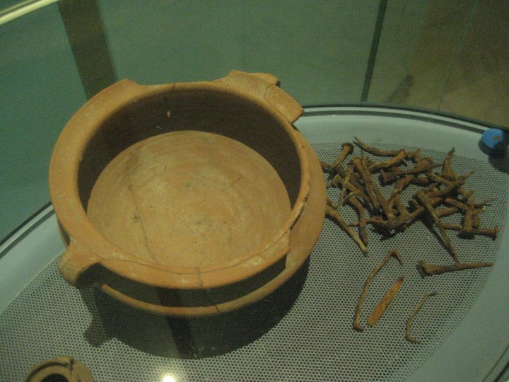 Cooking pot and nails found near the boat.