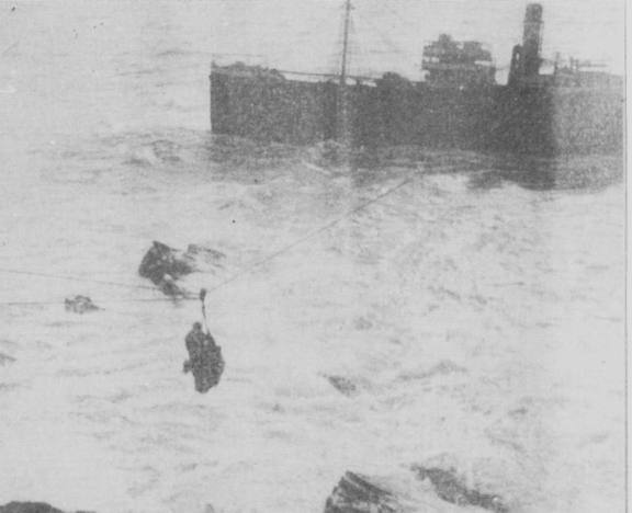 Some of the crew being rescued.