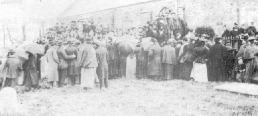 The interment of the victims in the mass grave.