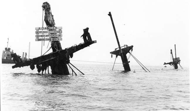 The wreck still sticks out of the water.