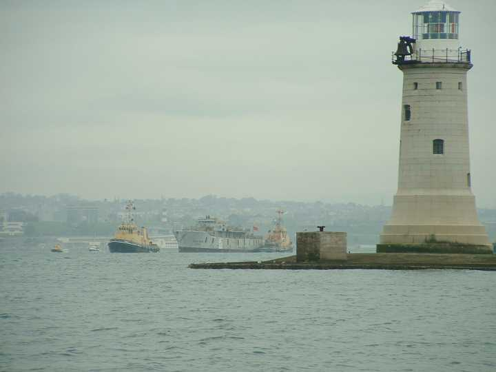Scylla being towed past the Breakwater en-route to her final destination.