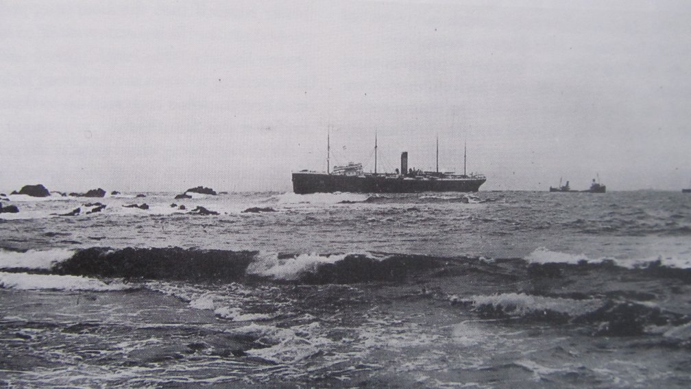 The Suevic held on the rocks.