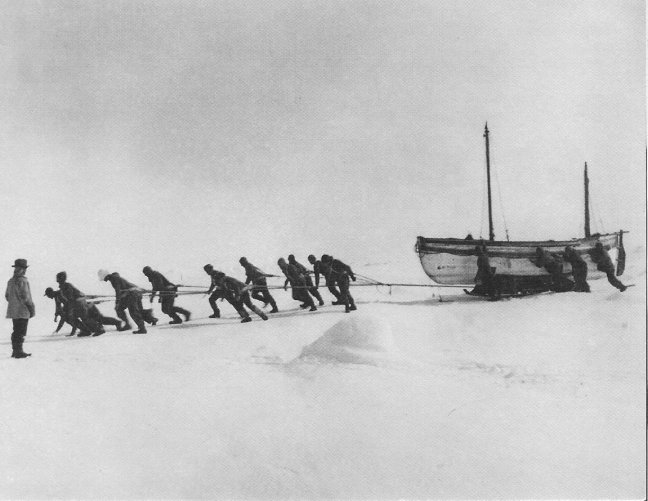 Hauling the boats across the pack ice. Photo Frank Hurley