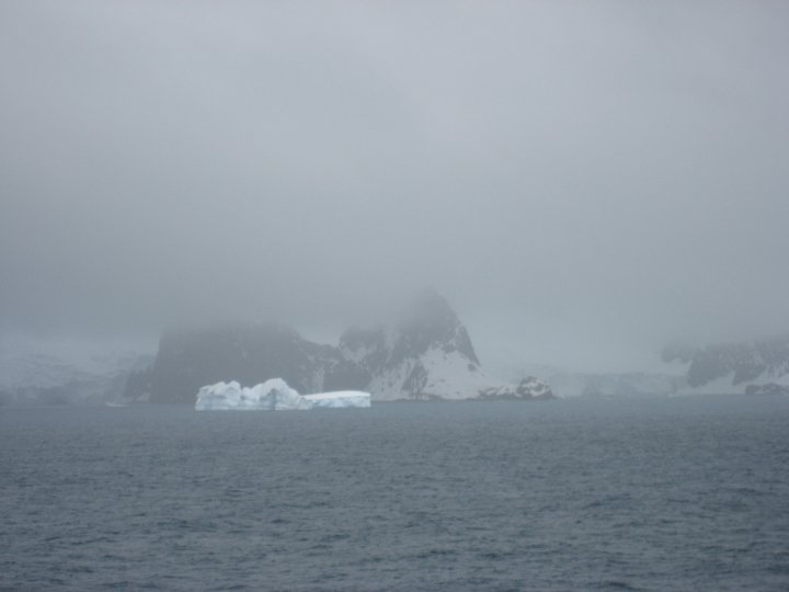 Half an hour later it started to snow, but there in the murk was Point Wild just to the right of the iceberg.